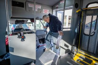 After shopping at The Corner Store, Whitehall resident Bruce Ball boards a Whitehall Public Transportation bus driven by LeRoy Murphy Feb. 21, 2020. (Ball has since passed away.)