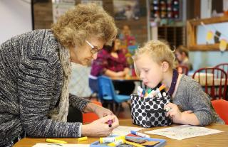 Pearl Hawkins colors with preschooler Kaylee Homen Jan. 10, 2020. Hawkins said she finds coloring relaxing, and enjoys the activity with students because she learns about them while they work together.